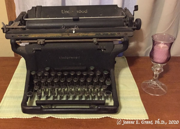 Photo of 1930s Underwood typewriter next to a candle