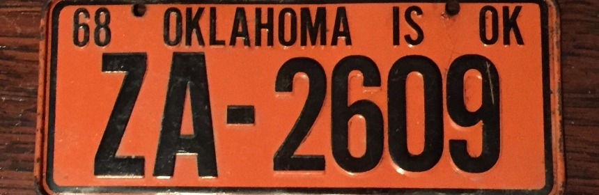 Orange bicycle license plate from 1968.
